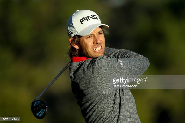 Aaron Baddeley of Australia plays his shot from the second tee during the First Round of the Sanderson Farms Championship at the Country Club of...