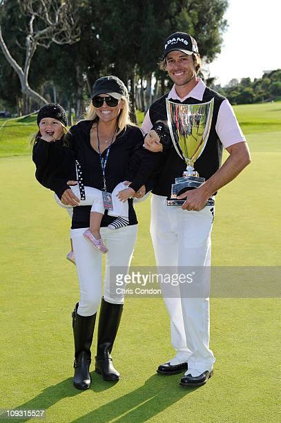 Aaron Baddeley of Australia poses his wife Richelle daughters Jewel and Jolee and the tournament trophy after winning the Northern Trust Open at...
