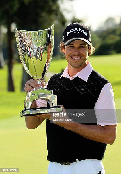 Aaron Baddeley of Australia poses with the trophy after the final round of the Northern Trust Open at Riviera Country Club on February 20 2011 in...