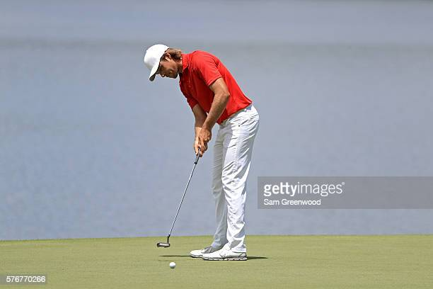 Aaron Baddeley of Australia putts on the third green during the final round of the Barbasol Championship at the Robert Trent Jones Golf Trail at...