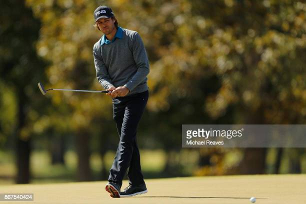 Aaron Baddeley of Australia reacts to a putt on the third hole during the third round of the Sanderson Farms Championship at the Country Club of...