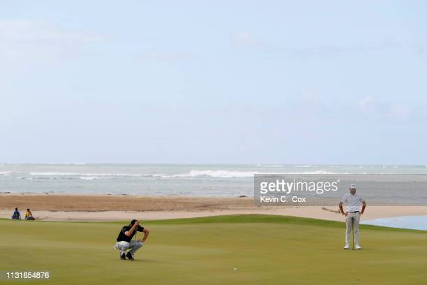Aaron Baddeley of Australia reads the 12th green as Curtis Luck of Australia looks on during the third round of the Puerto Rico Open at Coco Beach...