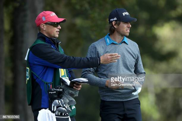 Aaron Baddeley of Australia talks with his caddie during the third round of the Sanderson Farms Championship at the Country Club of Jackson on...