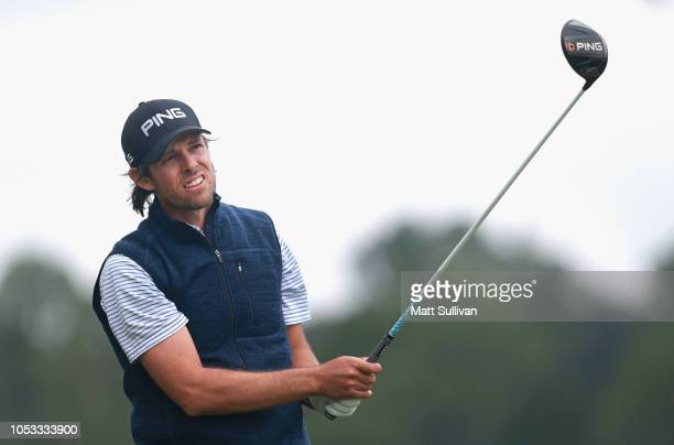 Aaron Baddeley of Australia watches his tee shot on the second hole during the first round of the Sanderson Farms Championship at the Country Club of...