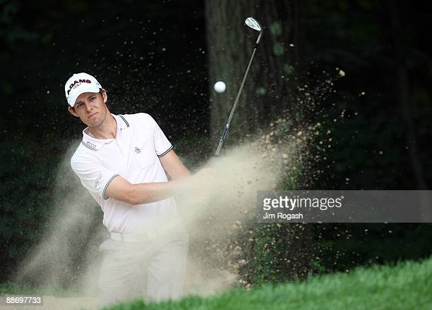 Aaron Baddeley of Australia works out of the rough during round two of the 2009 Travelers Championship at TPC River Highlands on June 26 2009 in...