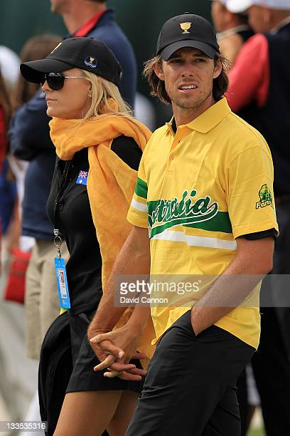 Aaron Baddeley of the International Team and his wife Richelle Baddeley walk together during the Day Four Singles Matches of the 2011 Presidents Cup...