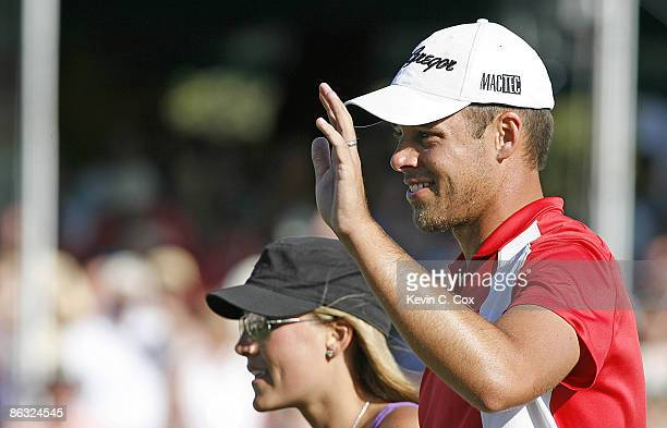 Aaron Baddeley waves to the gallery as he and his wife Richelle leave the 18th green after winning the 2006 Verizon Heritage Classic Sunday April 16...