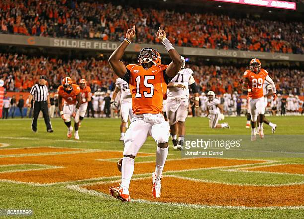 Aaron Bailey of the Illinois Fighting Illini celebrates scoring a touchdown against the Washington Huskies at Soldier Field on September 14 2013 in...
