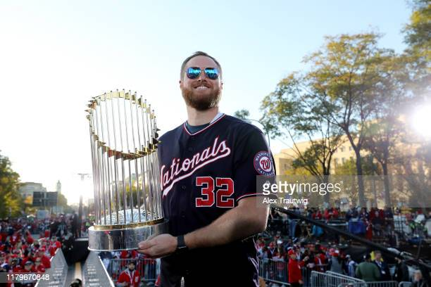 Aaron Barrett of the Washington Nationals poses for a photo with the Commissioner's Trophy during the 2019 World Series victory parade on Saturday...