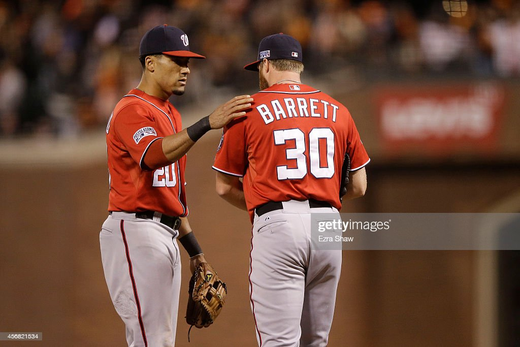 Aaron Barrett #30 talks to Ian Desmond #20 of the Washington Nationals after throwing a wild pitch in the seventh inning against the San Francisco Giants during Game Four of the National League Division Series at AT&T Park on October 7, 2014 in San Francisco, California.