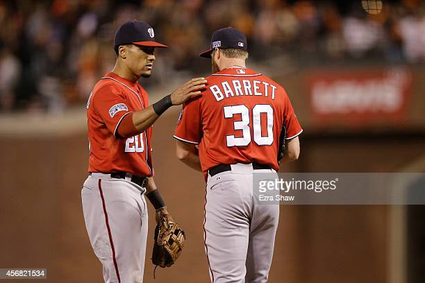 Aaron Barrett talks to Ian Desmond of the Washington Nationals after throwing a wild pitch in the seventh inning against the San Francisco Giants...