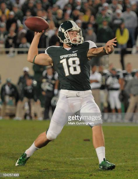 Aaron Bates of the Michigan State Spartans throws a game-winning touchdown pass on a fake field goal to teammate Charlie Gantt in overtime against...