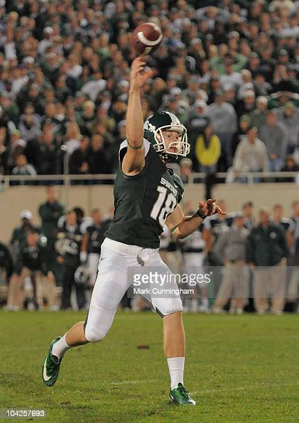 Aaron Bates of the Michigan State Spartans throws a game-winning touchdown pass on a fake field goal attempt to Charlie Gantt in overtime against the...