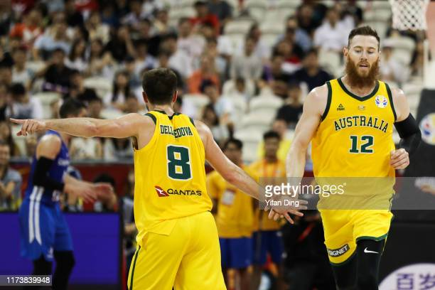Aaron Baynes of Australia reacts to a shot with teammate Matthew Dellavedova during the quarter final match between Australia and Czech Republic of...