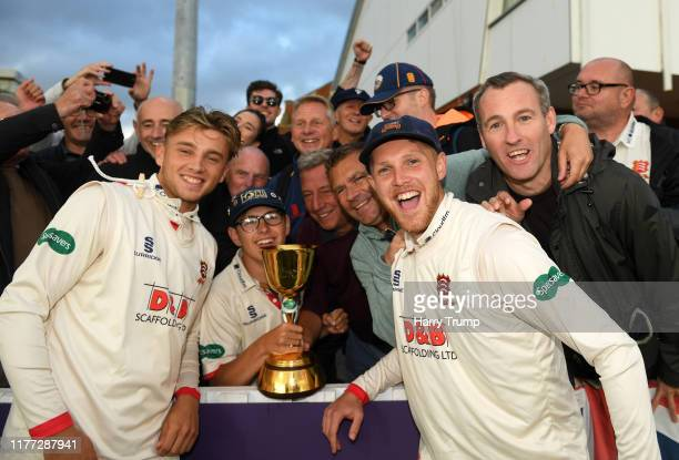 Aaron Beard of Essex and Jamie Porter of Essex celebrate with the crowd after winning the County Championship during Day Four of the Specsavers...