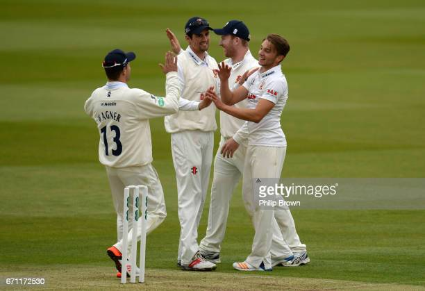 Aaron Beard of Essex is congratulated after dismissing Nick Gubbins during day one of the Specsavers County Championship Division One cricket match...
