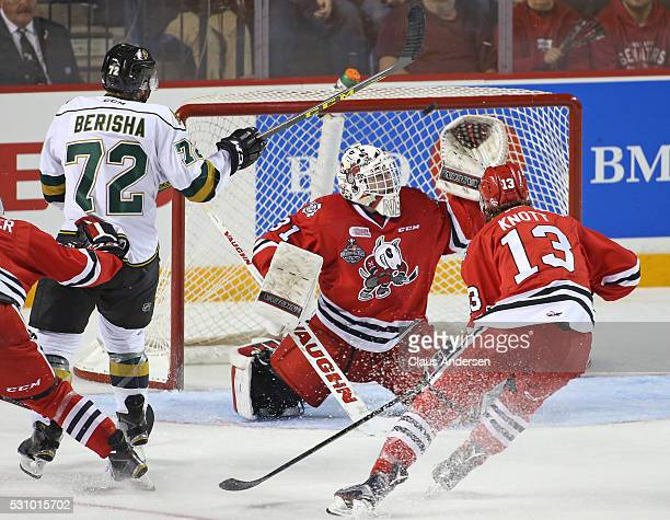 Aaron Berisha of the London Knights has a scoring attempt stopped by Alex Nedeljkovic of the Niagara IceDogs during Game Four of the OHL Championship...