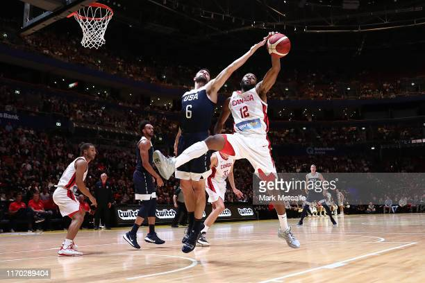 Aaron Best of Canada and Joe Harris of the USA compete for the ball during the International Friendly Basketball match between Canada and the USA at...
