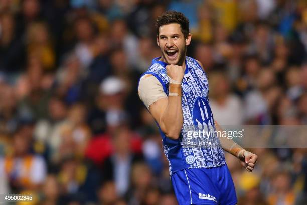 Aaron Black of the Kangaroos celebrates a goal during the round 11 AFL match between the West Coast Eagles and the North Melbourne Kangaroos at...