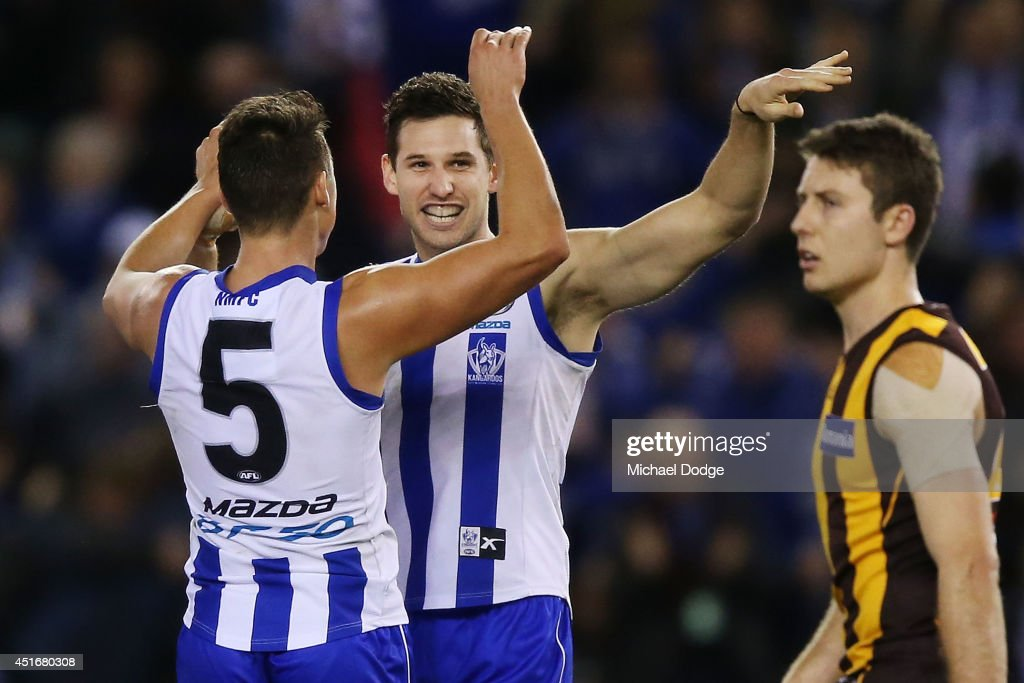 Aaron Black of the Kangaroos (C) celebrates a goal with Ben Jacobs of the Kangaroos during the round 16 AFL match between North Melbourne Kangaroos and the Hawthorn Hawks at Etihad Stadium on July 4, 2014 in Melbourne, Australia.