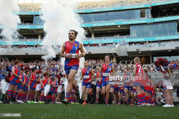 Aaron Black of West Perth leads the team onto the field during the WAFL Grand Final between Subiaco and West Perth at Optus Stadium on September 23...