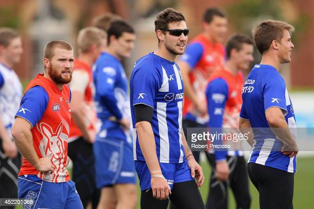 Aaron Black wears sunglasses during a North Melbourne Kangaroos AFL media session at Arden Street Ground on July 16, 2014 in Melbourne, Australia.