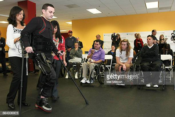 Aaron Bloom a 27 year old paraplegic demonstrates using a bionic suit that enables him to walk while at the Huntington Hospital Outpatient...