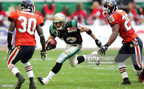 Aaron Boone of Berlin in action with B.J. Tucker and Ron Israel of Amsterdam during the Yello Strom World Bowl XIII between the Berlin Thunder and...