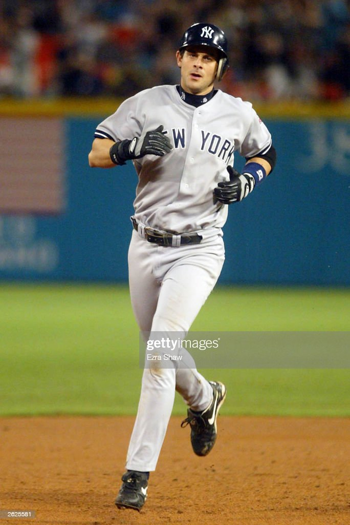 Aaron Boone #19 of the New York Yankees circle the bases after hitting a home run in the ninth inning against the Florida Marlins during Game 3 of the Major League Baseball World Series October 21, 2003 at Pro Player Stadium in Miami, Florida.