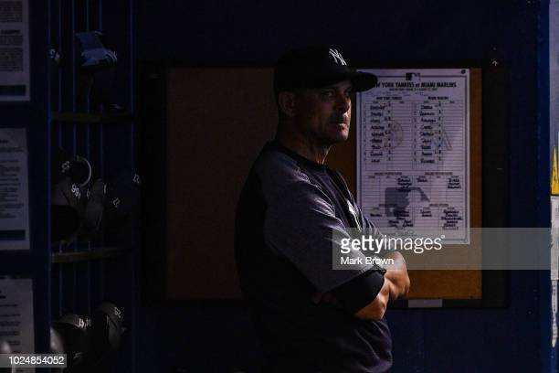 Aaron Boone of the New York Yankees in the dugout against the Miami Marlins at Marlins Park on August 22 2018 in Miami Florida