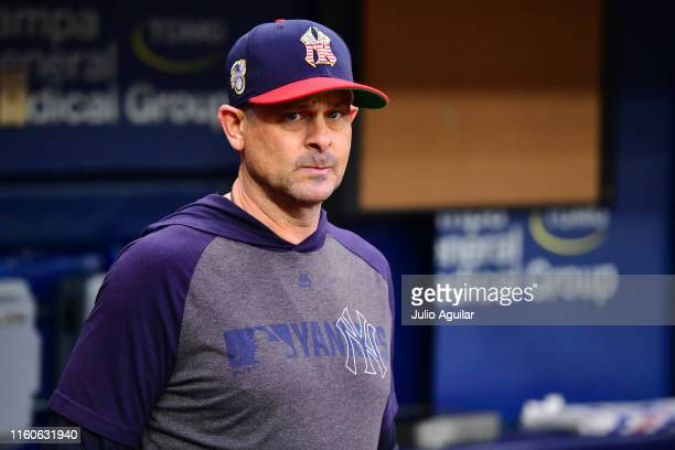 Aaron Boone of the New York Yankees looks on before a baseball game against the Tampa Bay Rays at Tropicana Field on July 07 2019 in St Petersburg...