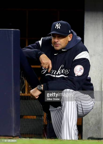 Aaron Boone of the New York Yankees looks on from the dugout against the Houston Astros in game five of the American League Championship Series at...