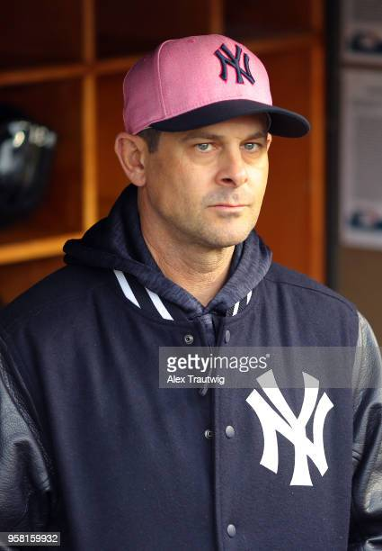 Aaron Boone of the New York Yankees looks on from the dugout ahead of a game against the Oakland Athletics at Yankee Stadium on Sunday May 13 2018 in...
