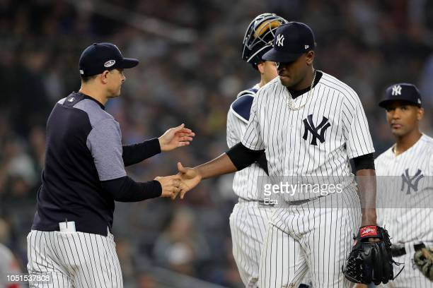 Aaron Boone of the New York Yankees pulls Luis Severino against the Boston Red Sox during the fourth inning in Game Three of the American League...