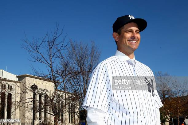 Aaron Boone poses for a photo after being introduced as manager of the New York Yankees at Yankee Stadium on December 6 2017 in the Bronx borough of...
