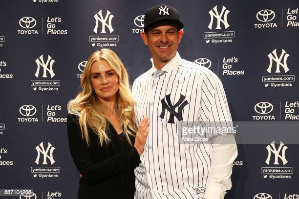 Aaron Boone poses for a photo with his wife Laura after being introduced as manager of the New York Yankees at Yankee Stadium on December 6 2017 in...