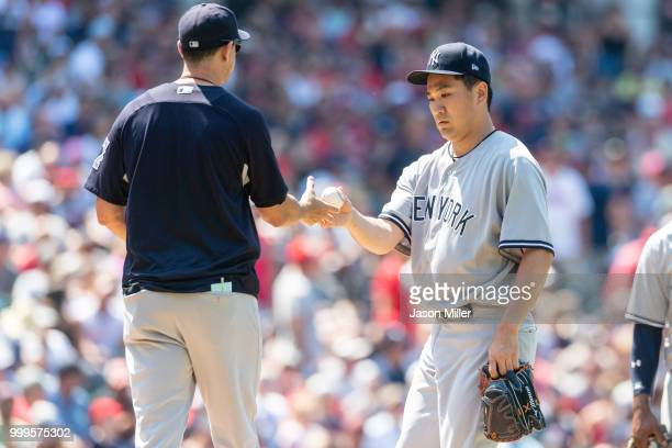 Aaron Boone removes Starting pitcher Masahiro Tanaka of the New York Yankees from the game during the seventh inning against the Cleveland Indians at...