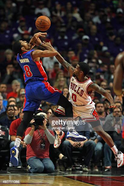 Aaron Brooks of the Chicago Bulls fould Spencer Dinwiddie of the Detroit Pistons during a preseason game at the United Center on October 14, 2015 in...