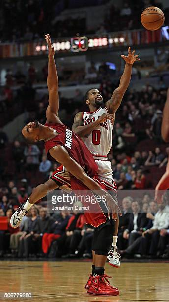 Aaron Brooks of the Chicago Bulls gets off a shot against Chris Bosh of the Miami Heat at the United Center on January 25 2016 in Chicago Illinois...