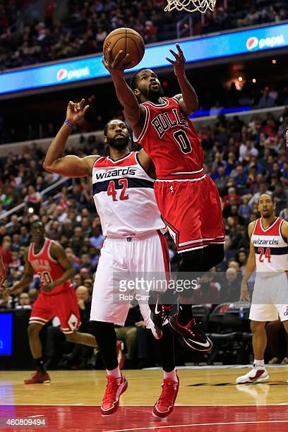 Aaron Brooks of the Chicago Bulls puts up a shot in front of Nene Hilario of the Washington Wizards during the first half at Verizon Center on...