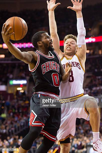 Aaron Brooks of the Chicago Bulls shoots over Matthew Dellavedova of the Cleveland Cavaliers during the first half at Quicken Loans Arena on January...