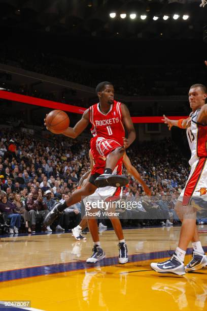 Aaron Brooks of the Houston Rockets delivers a pass against the Golden State Warriors on October 28 2009 at Oracle Arena in Oakland California NOTE...