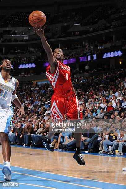 Aaron Brooks of the Houston Rockets goes to the basket against Nene of the Denver Nuggetson March 9 2009 at the Pepsi Center in Denver Colorado NOTE...