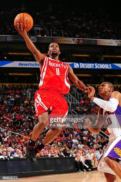 Aaron Brooks of the Houston Rockets goes to the basket against Leandro Barbosa of the Phoenix Suns during the game at US Airways Center on April 2010...