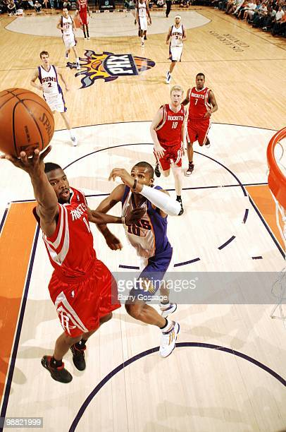 Aaron Brooks of the Houston Rockets makes a layup against Leandro Barbosa of the Phoenix Suns during the game at US Airways Center on April 2010 in...