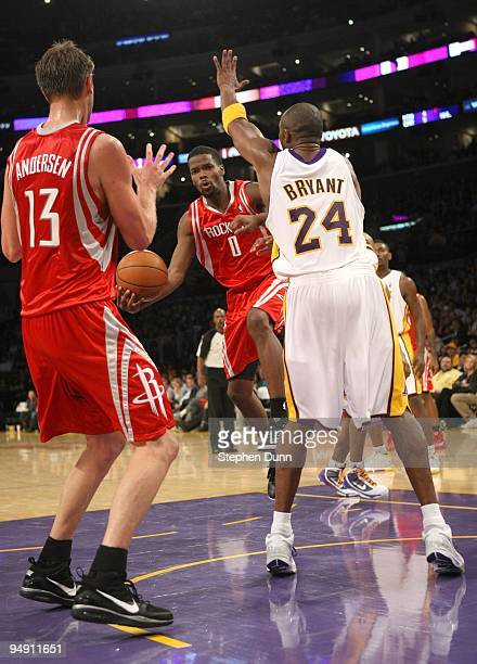 Aaron Brooks of the Houston Rockets passes the ball to David Andersen in front of Kobe Bryant of the Los Angeles Lakers on November 15 2009 at...