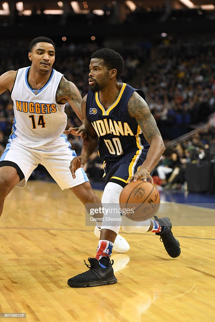 Aaron Brooks #00 of the Indiana Pacers dribbles against Jameer Nelson #14 of the Denver Nuggets as part of 2017 NBA London Global Games at the O2 Arena on January 12, 2017 in London, England.