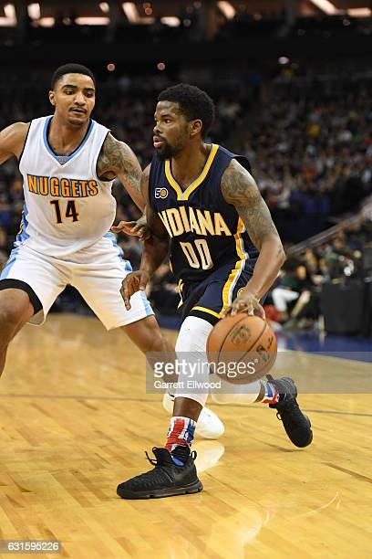 Aaron Brooks of the Indiana Pacers dribbles against Jameer Nelson of the Denver Nuggets as part of 2017 NBA London Global Games at the O2 Arena on...