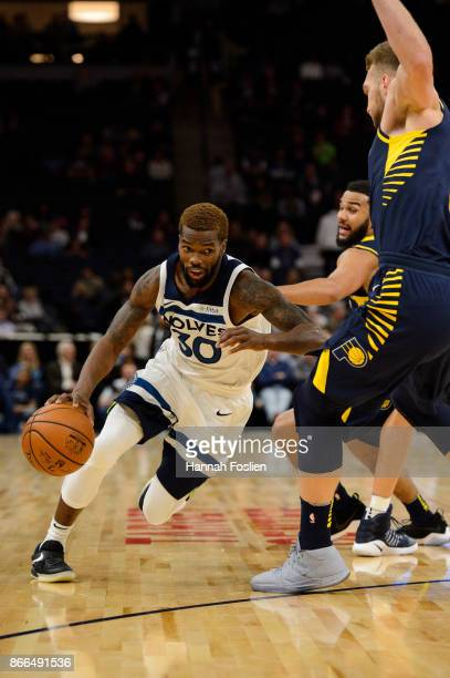 Aaron Brooks of the Minnesota Timberwolves drives to the basket against Cory Joseph and Domantas Sabonis of the Indiana Pacers during the game on...