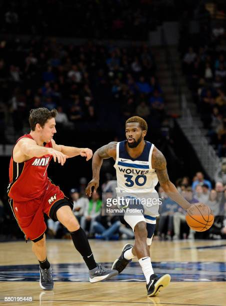 Aaron Brooks of the Minnesota Timberwolves drives to the basket against Goran Dragic of the Miami Heat during the game on November 24 2017 at the...